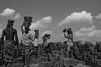Workers carrying mud bricks for burning The brick field workers work from dawn to dusk Najirhat, Chittagong, Bangladesh, December 10, 2008