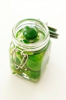 organic green hot cherry paprika in a jar