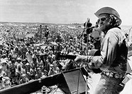 Country rock singer Willie Nelson opening the 'July 4th Picnic' music festival, 1974