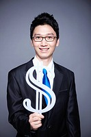 businessman holding dollar sign