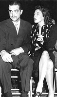 HOWARD HUGHES with date AVA GARDNER, late 1940s