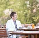 Man enjoying breakfast on outdoor patio
