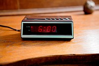 Digital alarm clock showing 6.00am