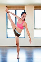 Woman stretching in dance studio