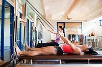 Two women doing pilates in gym
