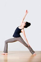 Woman in warrior position during yoga
