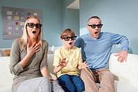 Family watching 3d movie at home