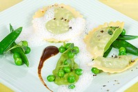 Pea ravioli with peas and watercress