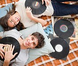 Couple listening to vinyl records together