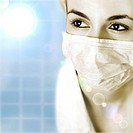 Female doctor with mask isolated on blue.
