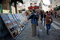 Norvins street with paints in Montmartre  Paris, France, Europe