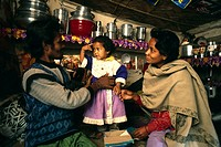 Mantu 30 yrs, left and Anguri 25 yrs, right with their daughter Mehjabeen in their small 6'X6' hut Mantu pulls a rickshaw on the streets of Calcutta t...