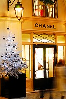 Paris, France, Chanel Shop Front, with Christmas Lights, and Christmas Trees on Display at Le Village Royal, Shopping Center, near Place de la Madelei...