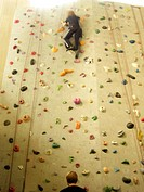 Boy climbing up on a wall in a sport center, Sweden