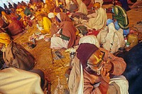 Things happening inside the beggars´ camp at Kumbha fair Kumbha mela India They come from every corner and occupy a big community tent laid for all Ha...