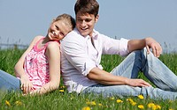 couple sitting on meadow