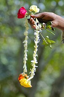 A mobile flower vendor shows a wreath at Ramna Park in Dhaka, the capital city of Bangladesh February 12, 2007