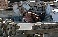 A Muslim devotee praying in the ruins of a mosque in Kakchira, Borguna, Bangladesh Many houses were destroyed by tidal wave on the night of 15th Novem...