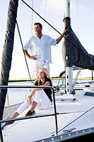 Father and teenage daughter on sailboat