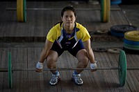 Gold medalist body builder Pavina Thongsuk at a military camp in Maerim district, Thailand January 19, 2007