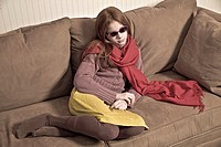 Preteen redhead girl wearing sunglasses and a long scarf