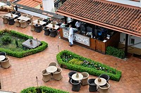 Yard of restaurant with waiting waiter, view from top, Prague, Czech Republic, Central Europe