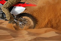 A DIRT BIKE AT THE DESERT SAFARI IN DUBAI