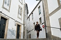 Woman in old city of Santiago de Compostela. Galicia, Spain