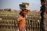 Child workers carrying bricks on their head at Fatullah Narayanganj, Bangladesh February 2011