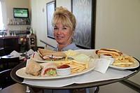 Florida, Miami Beach, Normandy Shores Golf Club, restaurant, waitress, food, tray, sandwiches, French fries,
