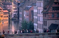 Pedestrians on the Ponts_couverts Covered_bridges over the River Ill, overlooking the Petite France quarter, Grande Ile, UNESCO World Heritage Site, S...