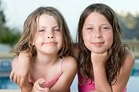Spain, Costa Blanca, Two girls 6_7,8_9 embracing
