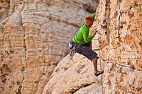 A male climber sport climbing in Red Rocks, Las Vegas, Nevada, United States of America