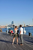 Young couple in Port Vell, Barcelone, Catalonia, Spain