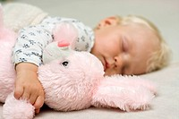 Sleeping baby girl,1 year, with plushy bunny