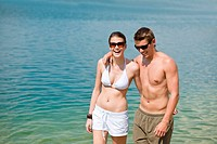 Couple in swimwear enjoy water and sun at sea