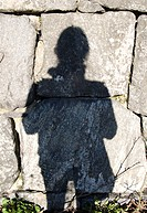 Human Shadow Against Rock Wall