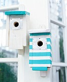 Nesting boxes with stripes.