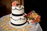 A wedding cake decorated with flowers and birds