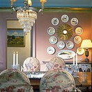 DINING ROOM _Crystal Chandelier, fish plate collection. Rose wall, gold crown molding, blue ceiling, slip covered dining chairs, crystal goblets on ta...
