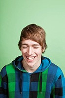 A laughing teenage boy, portrait, studio shot
