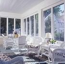 Sunrooms, Enclosed add_on salvaged porch, pale yellow wood, white trim. White wicker furniture, rocker, dining table with glass top & chairs with blue...