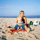 Mother and child on a beach, Skane, Sweden.