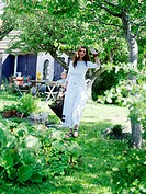 A woman in a garden, Skane, Sweden.