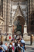 Tourists queuing at entrance to the cathedral, Seville, Andalusia, Spain