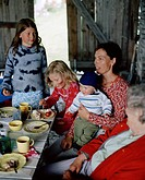 Two women and a three children having a cake, Oland, Sweden.