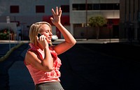 Pretty exasperated woman talks on cell phone