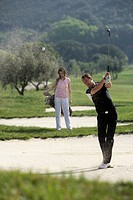 A Scandinavian man playing golf, Italy.