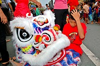 A lion dance performer from the artist troupe Ho Hap Kwee at the Chinese New Year Parade in Yogyakarta The lion dance is a traditional performance for...