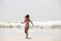 A Scandinavian girl playing on the beach, Brazil.